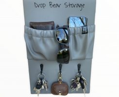 Triple hook with a storage pocket in vinyl. stone colour. 100% australian made and owned